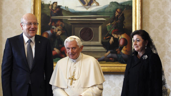 Pope Benedict XVI meets Lebanon's Prime Minister Najib Mikati  and his wife May at the Vatican Monday, Nov. 28, 2011. (AP Photo/Alessandro Bianchi, Pool)