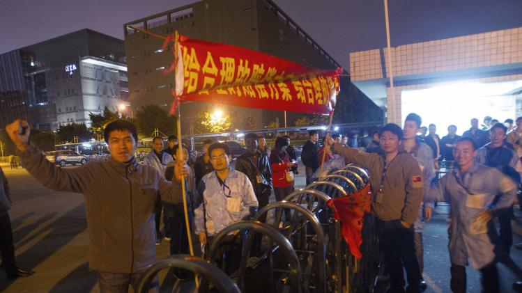 File photo of IBM workers protesting at the gate outside an IBM factory in Shenzhen
