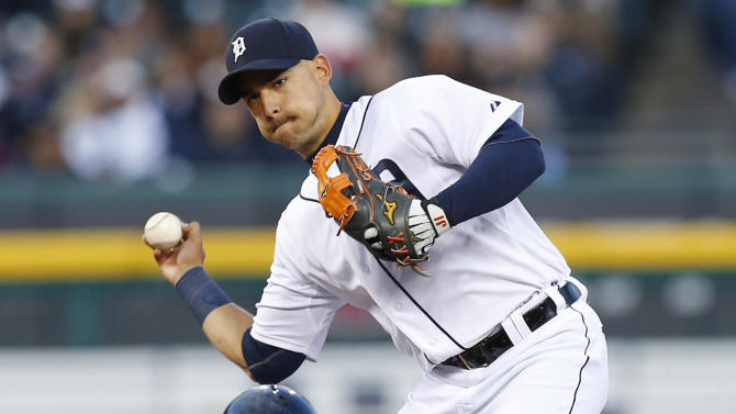 Detroit Tigers shortstop Jose Iglesias, top, throws to first base as Cleveland Indians' David Murphy (7) slides to complete a double play on a Roberto Perez ground ball in the fourth inning of a baseball game in Detroit, Friday, April 24, 2015. (AP Photo/Paul Sancya)