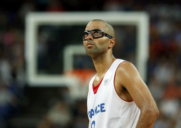 France's Parker looks at the scoreboard during his team's game against Spain at their men's quarterfinal basketball match at the North Greenwich Arena in London during the London 2012 Olym