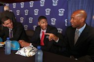 New Orleans Hornets head coach Monty Williams gestures while talking to 2012 NBA Draft picks Austin Rivers, left, and Anthony Davis, in New Orleans Friday June 29, 2012. Davis was the first pick of the first round and Rivers the 10th pick of the first round Thursday night.  (AP Photo/Kerry Maloney)