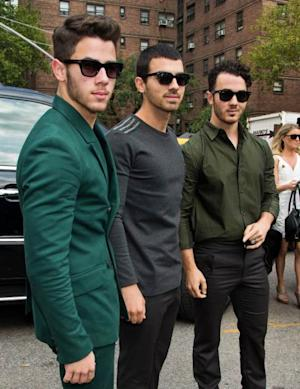 Nick Jonas, Joe Jonas and Kevin Jonas of Jonas Brothers attend 2014 Mercedes-Benz Fashion Week during day 1 on September 5, 2013 in New York City -- Getty Images