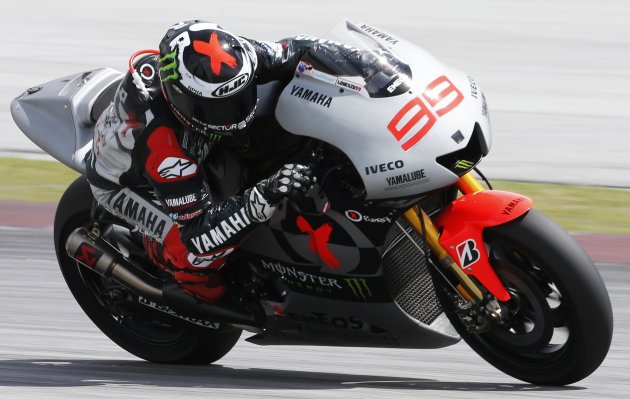Yamaha MotoGP rider Lorenzo of Spain rides after taking a corner during a pre-season test in Sepang