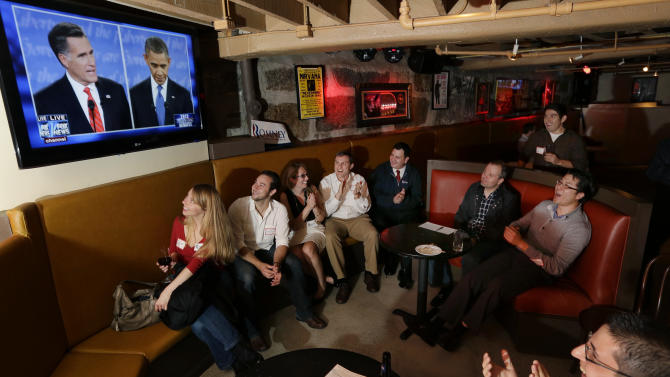 FILE - In this Oct. 3, 2012 file photo members of the Massachusetts GOP Young Republicans react as they watch the first presidential debate between President Barack Obama and Republican Mitt Romney in Boston. Republicans lost the popular vote for the fifth time in the last six presidential elections with the latest loss due in large measure to Obama's advantage over Romney among younger and non-white voters. Young party leaders say Republicans aiming to reach beyond the party's white, aging core need to do more than just retool campaign strategy and tactics. They also need GOP elected officials to offer concrete policies to counter Democratic initiatives. (AP Photo/Elise Amendola, File)