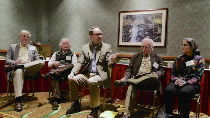 FILE - In this file photo from March 7, 2014, historians and members of the Midwest History Working Group from left to right, John Miller, Mike Allen, Jon Lauck, Kurt Leichtle and Catherine Cocks  attend a meeting in Omaha, Neb., Friday, March 7, 2014. One of the ideas they came up with was to publish an online journal on a shoestring budget. But the University of Nebraska Press expressed interest in publishing a printed journal, and the group jumped at the chance. (AP Photo/Nati Harnik)