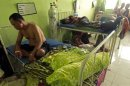 Patients rest in a hospital in Makassar, South Sulawesi province