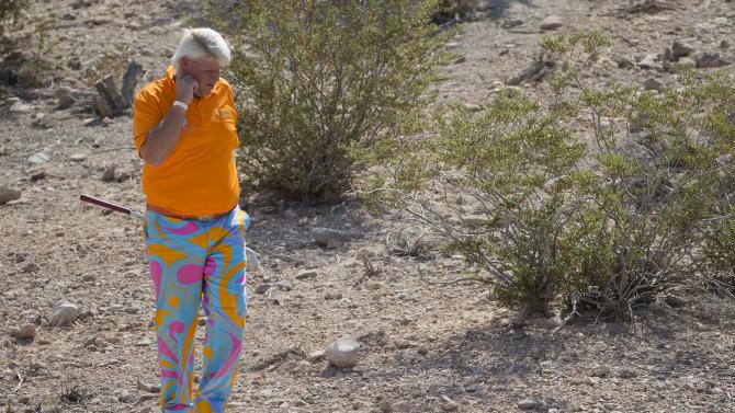 John Daly walks up to his ball in the rough on the third hole during the third round of the Justin Timberlake Shriners Hospitals for Children Open golf tournament, Saturday, Oct. 6, 2012, in Las Vegas. (AP Photo/Julie Jacobson)