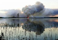 <p>Smoke billows as a bushfire burns near Green Point in New South Wales in this photo provided by New South Wales Rural Fire Service on January 8, 2012. After facing one of the highest-risk fire days in its history on Tuesday, residents in hard-hit New South Wales state woke to much cooler conditions as a southerly change dropped temperatures significantly.</p>