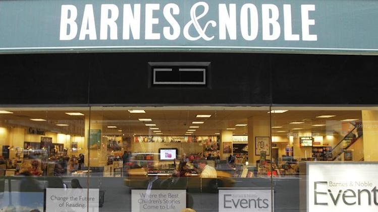 A woman looks in from a window panel of a Barnes & Noble store in New York