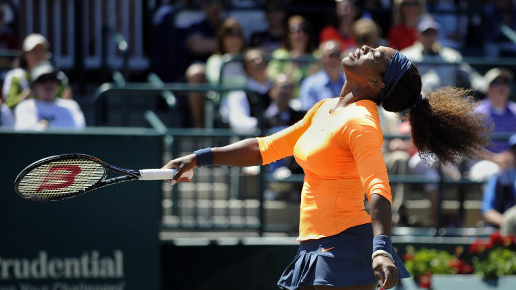 Serena Williams reacts after hitting a shot wide during a semifinal match against her sister Venus Williams at the Family Circle Cup tennis tournament in Charleston, S.C., Saturday, April 6, 2013. Serena won 6-1, 6-2. (AP Photo/Stephen Morton)