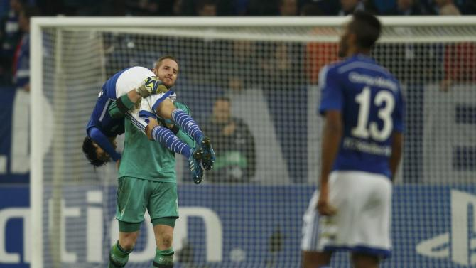 Schalke 04's goal keeper Faehrmann celebrates with Uchida following their victory over Sporting in their Champions League group G soccer match in Gelsenkirchen