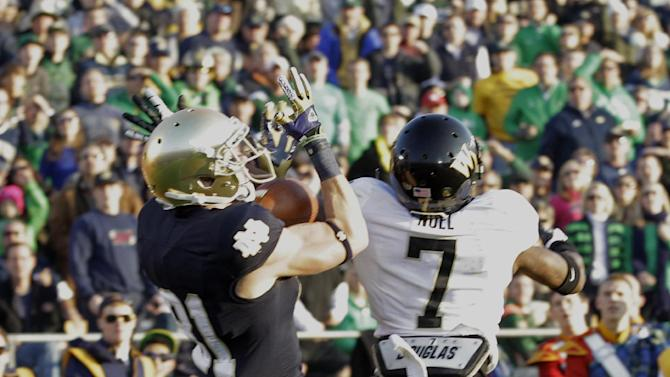 Notre Dame wide receiver John Goodman, right, makes a catch for a touchdown over Wake Forest cornerback Merrill Noel during the first half of an NCAA college football game in South Bend, Ind., Saturday, Nov. 17, 2012. (AP Photo/Michael Conroy)
