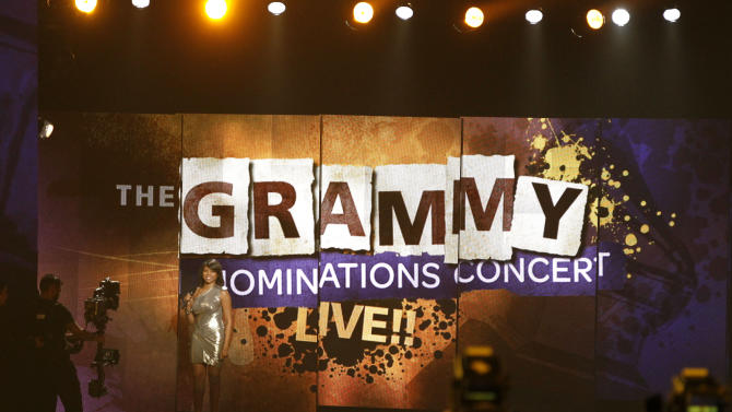 FILE - In a Nov. 30, 2011 file photo, Taraji P. Henson announces the song of year at the Grammy Nominations Concert in Los Angeles. The National Academy of Recording Arts & Sciences will have its annual live nominations concert special in Nashville, Tenn., Dec. 5, 2012.    (AP Photo/Matt Sayles, File)