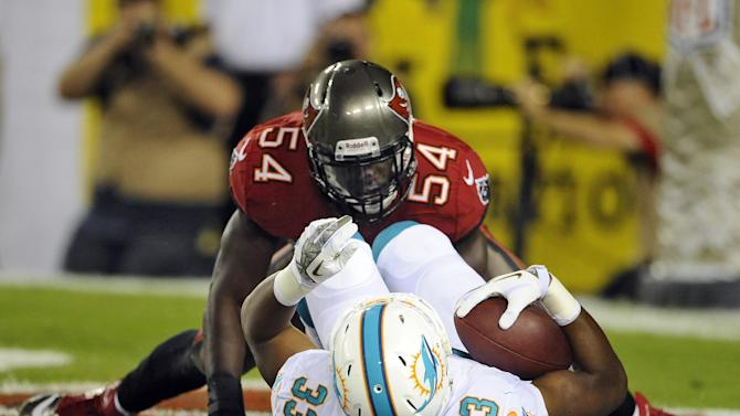 Tampa Bay Buccaneers outside linebacker Lavonte David (54) tackles Miami Dolphins running back Daniel Thomas (33) in the end zone for a safety during the second quarter of an NFL football game Monday, Nov. 11, 2013, in Tampa, Fla. (AP Photo/Brian Blanco)