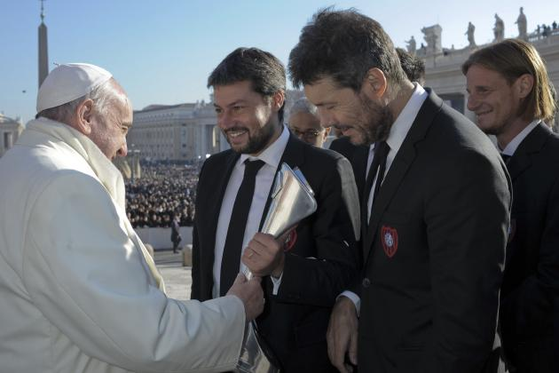 San Lorenzo players presents Pope Francis with a replica of the Argentine soccer championship trophy during the Wednesday general audience at the Vatican
