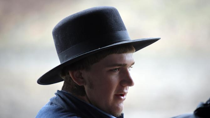 In this photo made on Tuesday, Jan. 29, 2013, Edward Mast, a 19-year-old grandson of one of the sixteen men and women facing sentencing Friday, Feb. 8, 2013 in beard-cutting attacks on fellow Amish in Ohio, talks at the family farm in Bergholz, Ohio. Mast worries what life will be like if the adults get long prison terms. (AP Photo/Keith Srakocic)