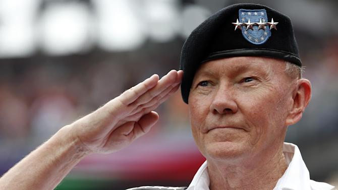 Gen. Martin Dempsey, Chairman of the Joint Chiefs of Staff, salutes during the national anthem while on the field for pre-game ceremonies before a baseball game between the Washington Nationals and the San Francisco Giants at Nationals Park, Saturday, July 4, 2015, in Washington. (AP Photo/Alex Brandon)