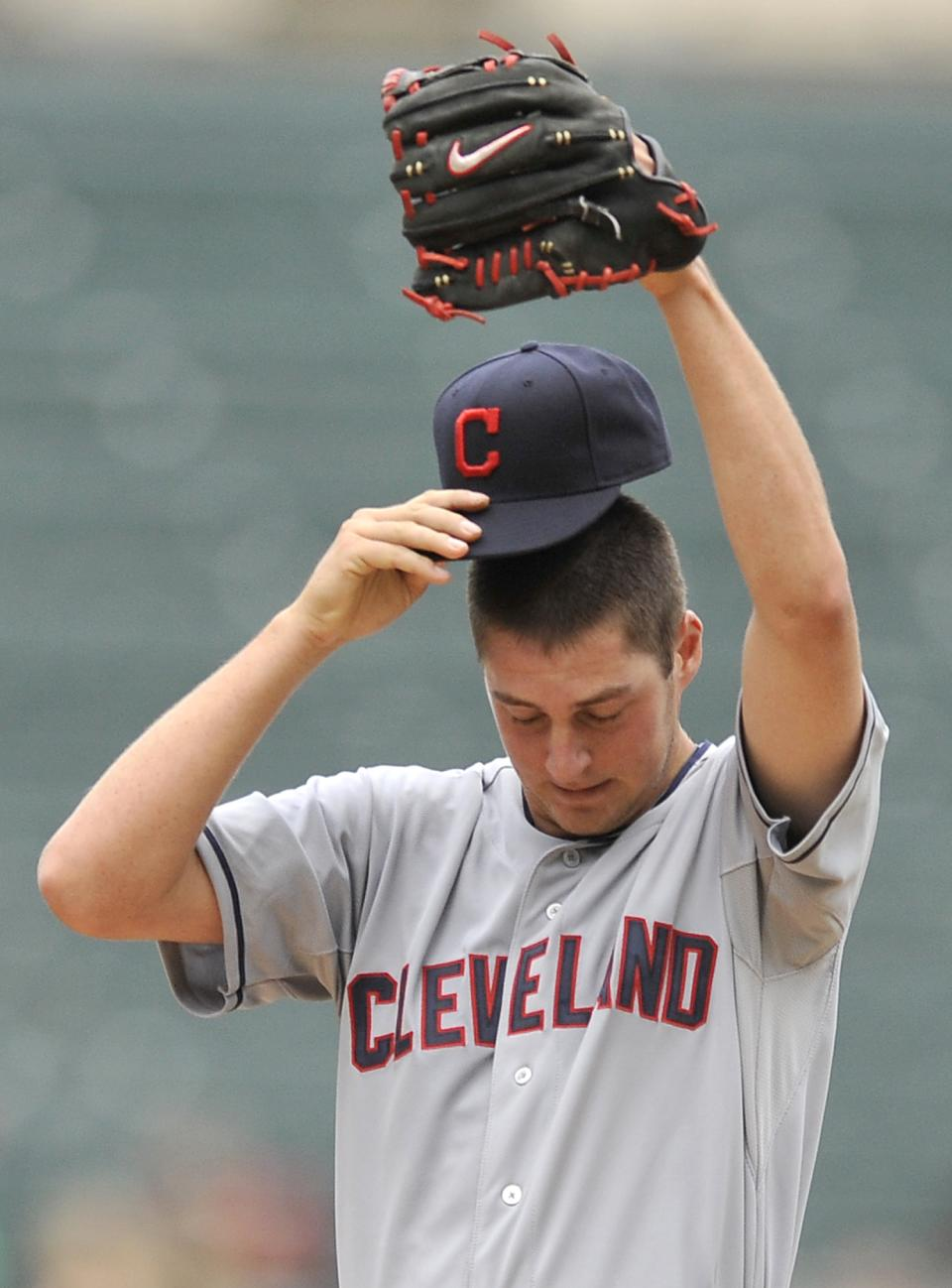 Cleveland Indians starter Trevor Bauer pauses after giving up two home runs during the first inning of the first baseball game of a doubleheader against the Chicago White Sox in Chicago, Friday, June 28, 2013. Bauer was removed from the game in the first inning. (AP Photo/Paul Beaty)