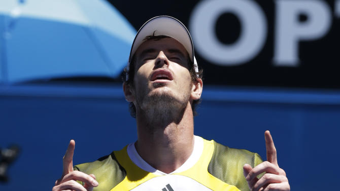 Britain's Andy Murray celebrates after defeating Robin Haase of the Netherland in their first round match at the Australian Open tennis championship in Melbourne, Australia, Tuesday, Jan. 15, 2013. (AP Photo/Andy Wong)