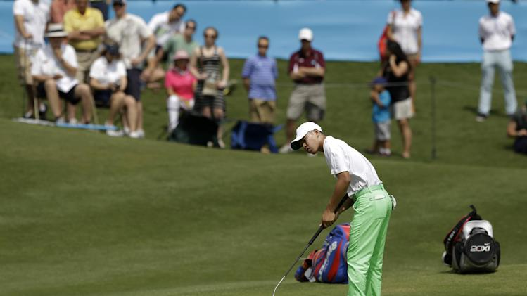 Amateur Guan Tianglang, 14, of China putts on the 18th green during the second round of the Byron Nelson Championship golf tournament Friday, May 17, 2013, in Irving, Texas. (AP Photo/Tony Gutierrez)