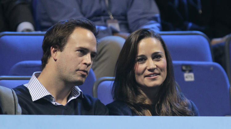 Pippa Middleton sister of Kate, Duchess of Cambridge, with unidentified friend, watches the mens tennis doubles final between Max Mirnyi of Belarus and Daniel Nestor of Canada against Mariusz Fyrstenberg of Poland and Marcin Matkowski of Poland at the ATP World Tour Finals, at the O2 arena in London, Sunday, Nov.  27, 2011. (AP Photo/SangTan)