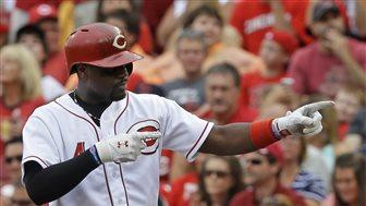 Votto drives in 2, Reds beat Pirates 5-4