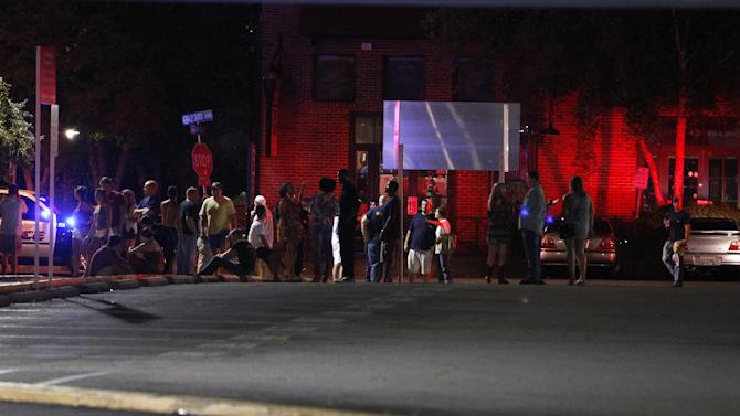 Tuscaloosa Police are on the scene of a shooting Tuesday morning July 17, 2012 in downtown Tuscaloosa, Ala. after a gunman who opened fire outside a crowded bar, wounding 17 people. Police were still searching for a suspect. (AP Photo/Tuscaloosa News, Robert Sutton)