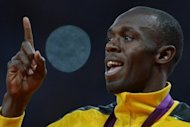 Jamaica's gold medalist Usain Bolt gestures on the podium of the men's 100m at the athletics event of the London 2012 Olympic Games on August 6. The 100m champion begins the defence of his 200m title