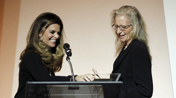Photographer Annie Leibovitz, right, and Maria Shriver greet each other at the 7th Annual MOCA Award to Distinguished Women in the Arts luncheon in Beverly Hills, Calif. Tuesday, May 1, 2012. The event honored Leibovitz.  (AP Photo/Matt Sayles)