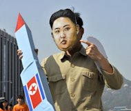 <p>A South Korean activist wearing a mask of North Korean leader Kim Jong-Un holds a mock missile during a rally denouncing North Korea's rocket launch in April. Washington and Seoul have urged Pyongyang to scrap the latest launch while Tokyo has postponed talks originally planned this week with North Korea.</p>