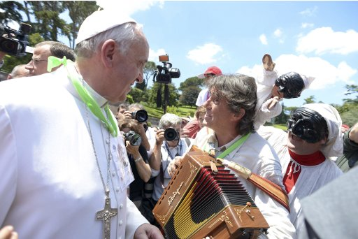 Pope Francis greets musicians as he welcomes more than 250 children who arrived after travelling by train from Milan at the St. Peter train station at the Vatican