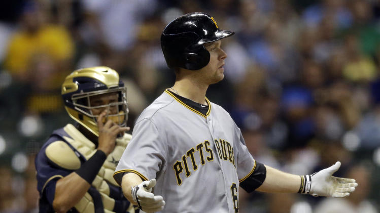 Pittsburgh Pirates' Justin Morneau, right, gestures to pitcher Milwaukee Brewers' Wily Peralta after being hit by a pitch during the fifth inning of a baseball game against the Milwaukee Brewers, Wednesday, Sept. 4, 2013, in Milwaukee. (AP Photo/Morry Gash)