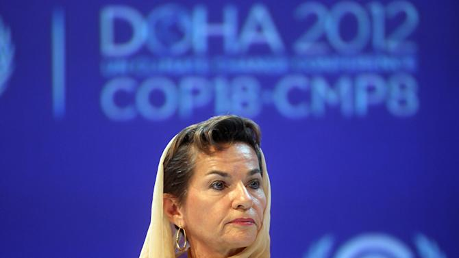 "FILE - In this Monday, Nov. 26, 2012 file photo, Christiana Figueres, Executive Secretary of the United Nations Framework Convention on Climate Change (UNFCCC)  attends the opening session of the United Nations Climate Change conference in Doha, Qatar. The United Nations climate chief is urging people not to look solely to their governments to make tough decisions to slow global warming, and instead to consider their own role in solving the problem. Approaching the half-way point of two-week climate talks in Doha, Christiana Figueres, the head of the U.N.'s climate change secretariat, said Friday, Nov. 30, 2012 that she didn't see ""much public interest, support, for governments to take on more ambitious and more courageous decisions."" (AP Photo/Osama Faisal, File)"