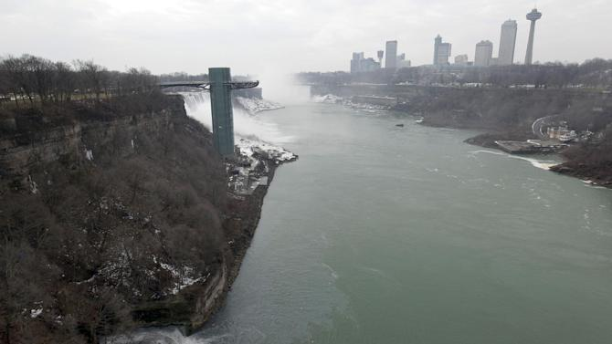 FILE -  In this Feb. 17, 2012 file photo, effluent from the Niagara Falls Wastewater Treatment Plant is discharged into the Niagara River near the American Falls in Niagara Falls, N.Y. In recent years, for economic reasons, Niagara Falls has thrown open its doors to casino gambling, gay weddings and a tightrope walk that, until laws were relaxed, would have meant arrest. It even briefly considered taking in toxic wastewater from hydraulic fracturing. On the drawing board now is a plan to entice young people to move in by paying down their student loans. (AP Photo/David Duprey, File)