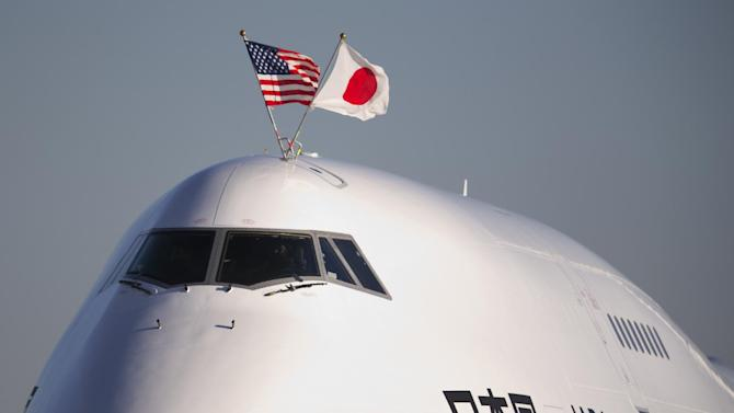 The flags of the United States and Japan are flown atop the plane carrying Japanese Prime Minister Shinzo Abe, as it arrives at Andrews Air Force Base, Md., Thursday, Feb. 21, 2013.  The Japanese prime minister is meeting President Barack Obama on Friday. (AP Photo/Manuel Balce Ceneta)