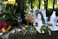Cigarettes, alcohol and photos are left with flowers and messages in 2011, near the house in north London where the body of pop star Amy Winehouse was found the previous day. The father of late British singer Winehouse details his daughter's cycle of drug and alcohol abuse in a new memoir due on bookshelves Tuesday in the United States