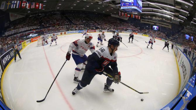 Slovakia's Dano fights for the puck with Norway's Norstebo during their ice hockey World Championship game in Ostrava