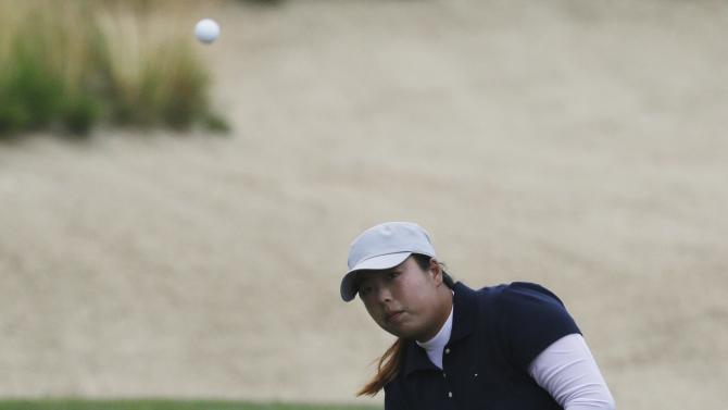Shanshan Feng, of China, hits from the fairway on the first hole during the second round of the U.S. Women's Open golf tournament at the Sebonack Golf Club Friday, June 28, 2013, in Southampton, N.Y. (AP Photo/Frank Franklin II)