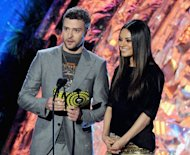 Actors Justin Timberlake (L) and Mila Kunis present an award onstage during the 2011 MTV Movie Awards. Timberlake and Kunis have accepted YouTube invitations from two US Marines, one serving in Afghanistan, to accompany them to military balls