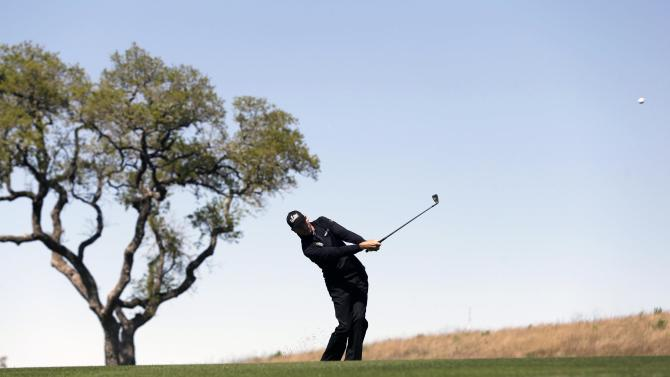 Jim Furyk hits an approach shot on the 10th hole during the first round of the Texas Open golf tournament on Thursday, April 4, 2013, in San Antonio. (AP Photo/Eric Gay)