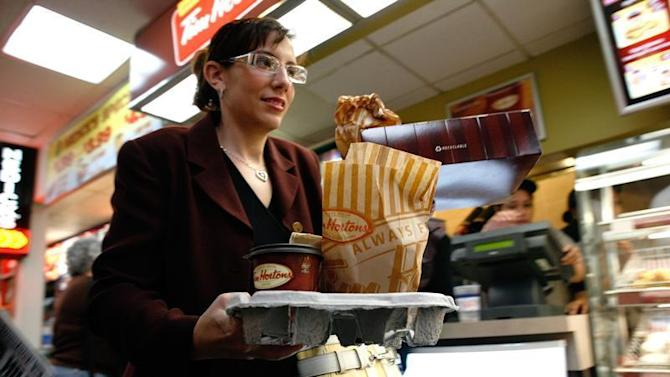 A customer exits a new Tim Hortons location in New York's Penn Station