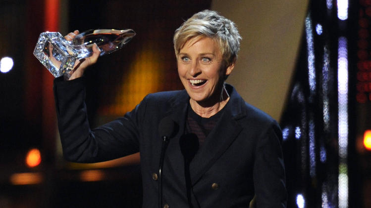 "FILE - In this Jan. 8, 2014 file photo, Ellen DeGeneres accepts the award for favorite daytime TV host at the 40th annual People's Choice Awards at the Nokia Theatre L.A. Live, in Los Angeles. CBS announced Thursday, April 10, 2014, that Stephen Colbert will succeed David Letterman as ""Late Show"" host, but there were other performers who could have been contenders, including DeGeneres, Jamie Foxx, Tina Fey, Amy Poehler, Louis C.K., Neil and Patrick Harris. (Photo by Chris Pizzello/Invision/AP, file)"