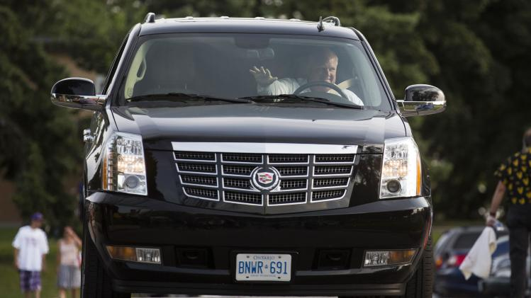 "Toronto Mayor Rob Ford arrives at ""Ford Fest"", a party held by the Ford family where the public is invited, at Thomson Memorial Park in Toronto"