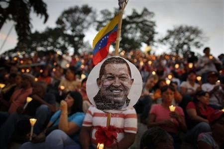 People hold candles during a praying ceremony for the health of Venezuelan President Hugo Chavez in Caracas February 22, 2013. REUTERS/Jorge Silva