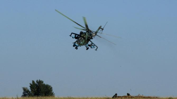A Ukrainian Mi-24 helicopter gunship flies above a military base in the eastern Ukrainian town of Kramatorsk