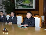 North Korean leader Kim Jong-Un talks with Wang, the head of the International Liaison Department of China's Communist Party, during their meeting in Pyongyang