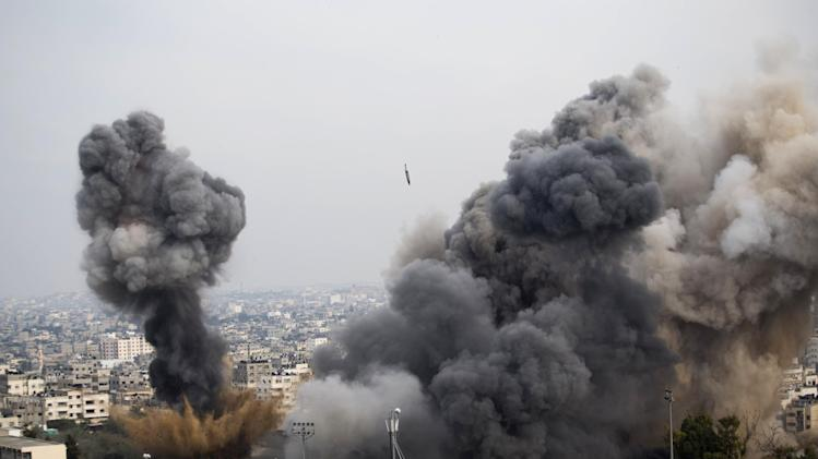 Smoke billows from the site of an Israeli airstrike in Gaza City, Wednesday, Nov. 21, 2012. Israeli aircraft pounded Gaza with at least 30 strikes overnight, hitting government ministries, smuggling tunnels, a banker's empty villa and a Hamas-linked media office.(AP Photo/Bernat Armangue)