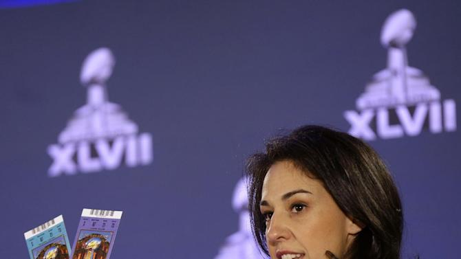 Anastasia Danias, vice president of legal affairs for the NFL, holds samples of legitimate tickets, at a news conference regarding counterfeit Super Bowl merchandise and tickets  for the upcoming Super Bowl XLVII in New Orleans, Thursday, Jan. 31, 2013. (AP Photo/Gerald Herbert)