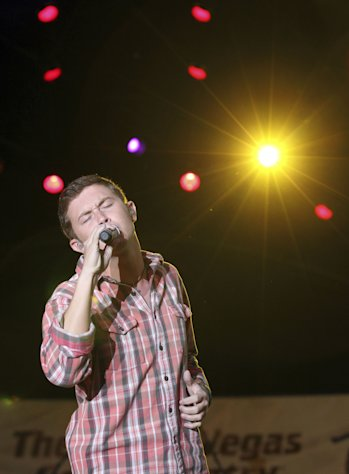 "FILE - This March 30, 2012 file photo shows Scotty McCreery performing at a concert hosted by The Academy of Country Music at the ACM Fremont Street Experience in Las Vegas. The platinum-selling teen and former ""American Idol"" champ began his freshman year at North Carolina State University recently and he's managed to work out a schedule that allows him to balance his college education with his country music education. (AP Photo/Jeff Bottari, file)"