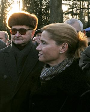 FILE -In this Nov.18, 2008 file photo, Monika Jaruzelska, right, and her father, Poland's last communist leader Gen. Wojciech Jaruzelski, left, attend the funeral of former prime minister Mieczyslaw Rakowski, in Warsaw, Poland. In her recent book Jaruzelska says her father's innate pessimism and fear dictated his decision to impose martial law against the Solidarity freedom movement in 1981. (AP Photo/Alik Keplicz)